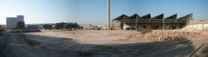 Wide shot of buildings at demolition site