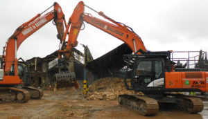 Hughes and Salvidge vehicles at demolition site