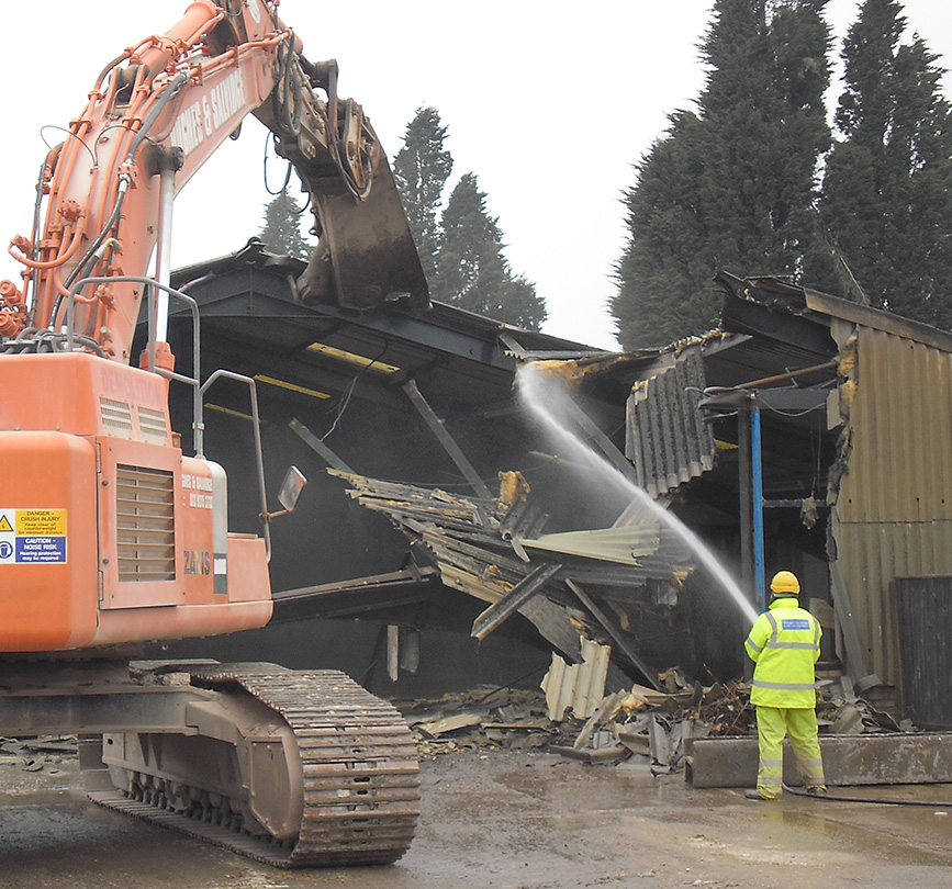 Asbestos is safely removed to prepare for a building demolition