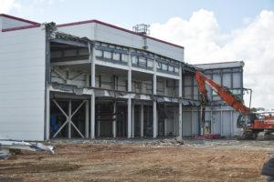 Hughes and Salvidge Vehicle demolishing large building