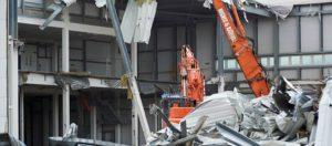 Hughes and Salvidge vehicles demolishing building