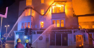 Restaurant on fire being put out by firefighters