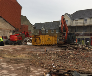 Demolition site with multiple vehicles in Bognor