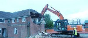 Small photo of Hughes and Salvidge vehicle demolishing building