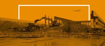 Orange image of Hughes and Salvidge vehicles at demolition site
