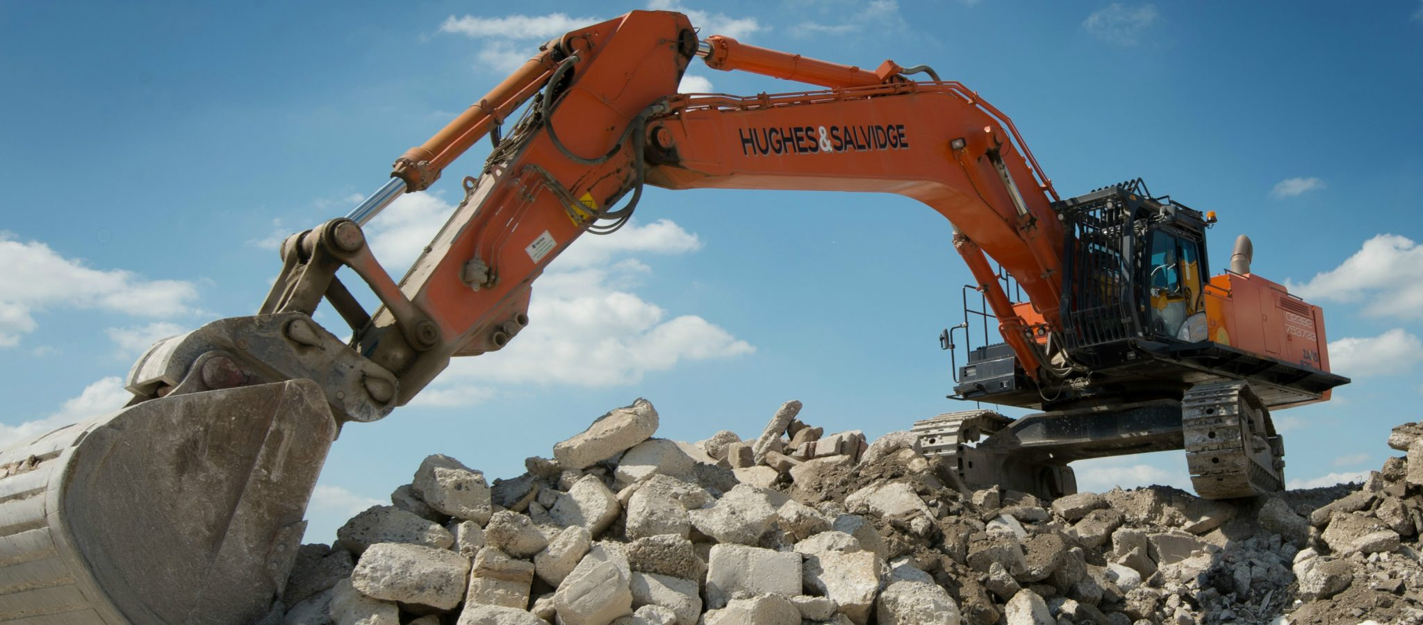 Hughes and Salvidge digger on rubble