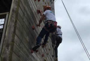 Man up climbing wall