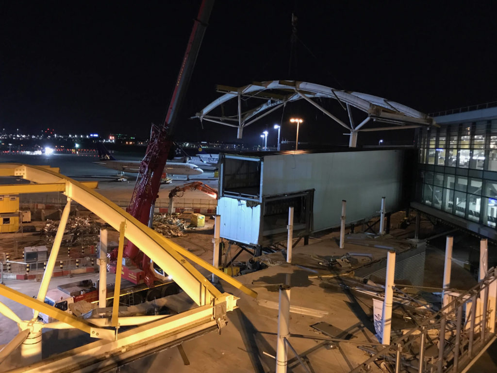 Removal of the Europier roof at night, London Heathrow Airport